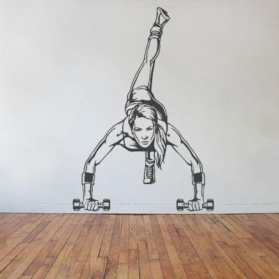 Наклейка Девушка-спортсменка с гантелями на стену